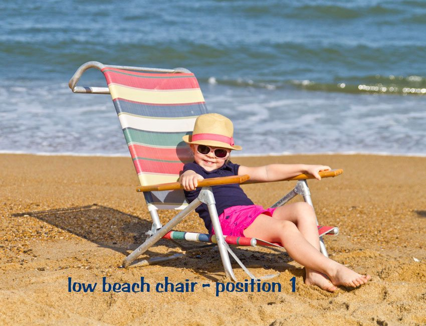 Low beach chair upright